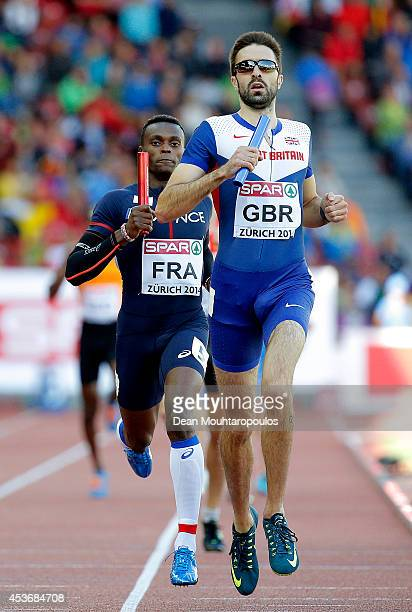 Martyn Rooney of Great Britain and Northern Ireland races to the line ahead of Thomas Jordier of France in the Men's 4x400 metres relay heats during...