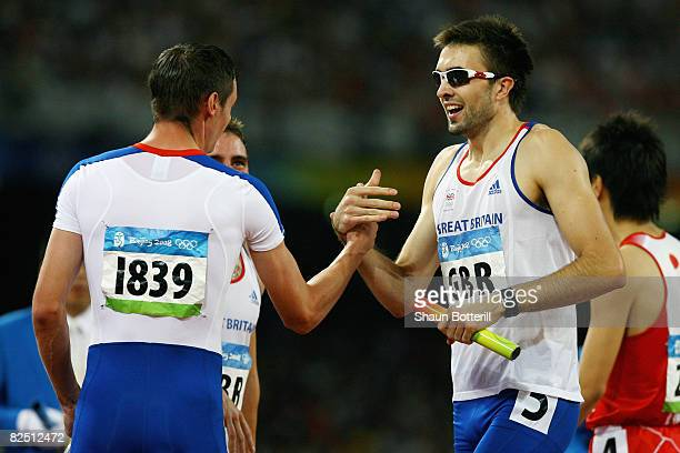 Martyn Rooney of Great Britain celebrates victory with Robert Tobin in the Men's 4 x 400m Relay Round 1 Heat 2 at the National Stadium on Day 14 of...