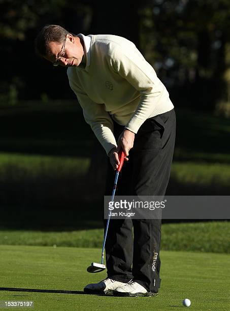 Martyn Thompson of Parkstone GC putts out during day 2 of the Skins PGA Fourball Championship at Forest Pines Hotel Golf Club on October 4 2012 in...