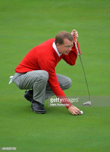Martyn Thompson of Parkstone Golf Club lines up a putt on the 16th green during the first round of the Lombard Trophy Grand Final at Gleneagles on...