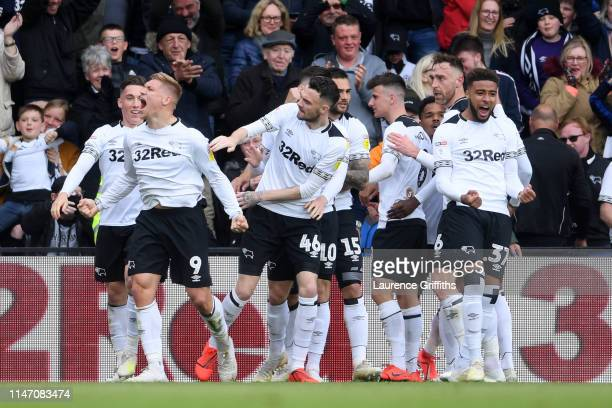 Martyn Waghorn of Derby County celebrates as he scores his team's first goal with team mates during the Sky Bet Championship match between Derby...