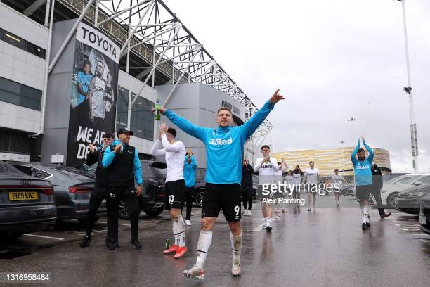 Martyn Waghorn of Derby County celebrates their side's safety outside the ground after the Sky Bet Championship match between Derby County and...