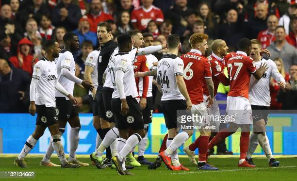 Martyn Waghorn of Derby County is pulled away by Tendayi Darikwa of Nottingham Forest at the end of the match during the Sky Bet Championship match...