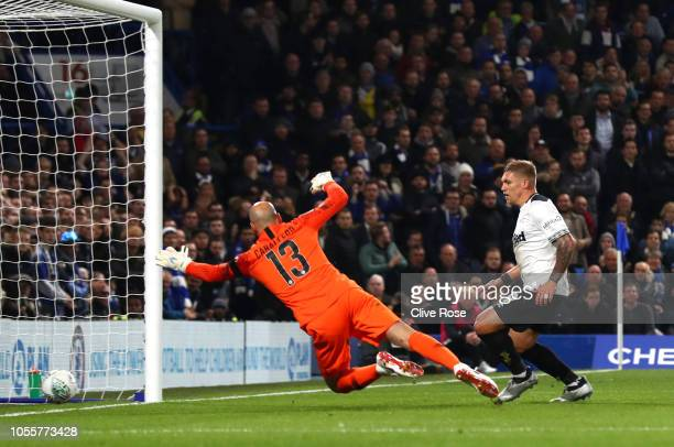 Martyn Waghorn of Derby County scores his team's first goal past Willy Caballero of Chelsea during the Carabao Cup Fourth Round match between Chelsea...