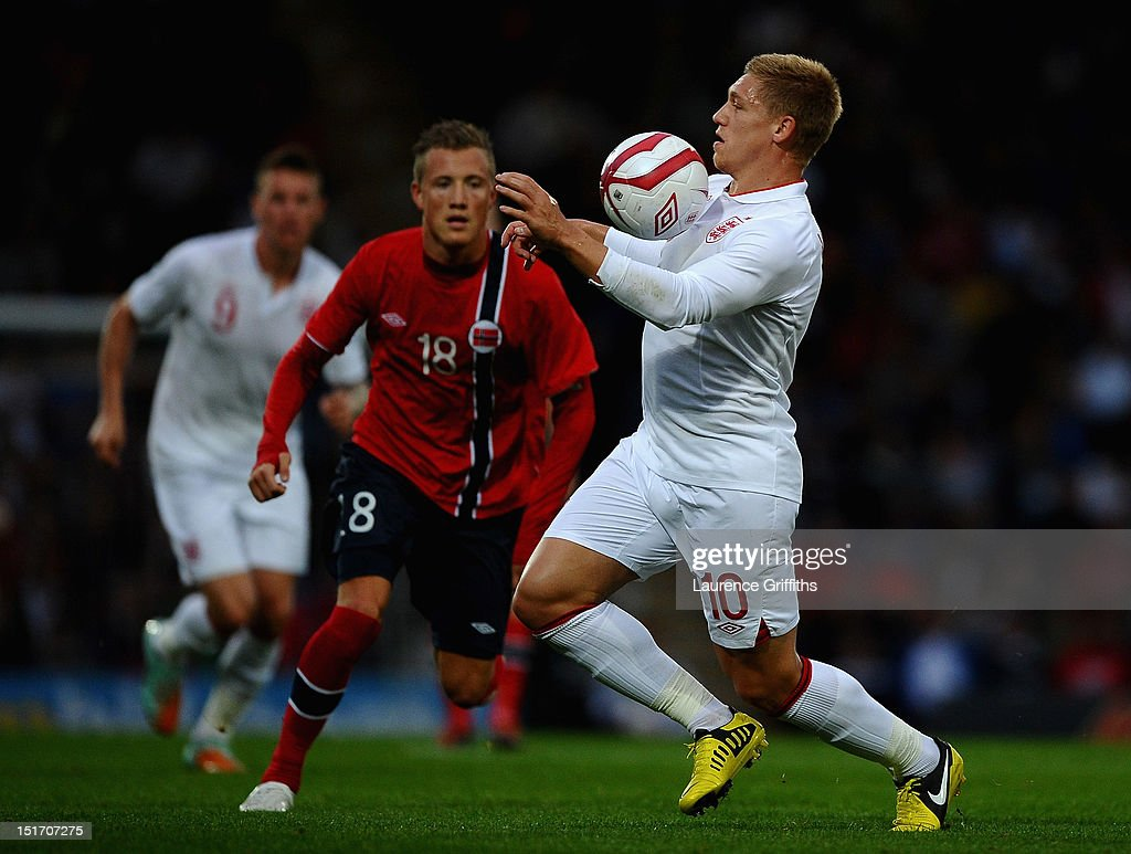 Martyn Waghorn of England battles with Fredrik Ulvestad of Norway during the UEFA Under-21 EURO 2013 Group 8 Qualifier between England and Norway at Proact Stadium on September 10, 2012 in Chesterfield, England.