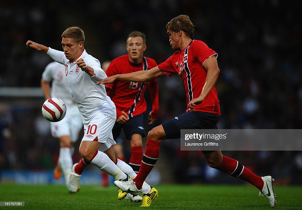 Martyn Waghorn of England battles with Thomas Rogne of Norway during the UEFA Under-21 EURO 2013 Group 8 Qualifier between England and Norway at Proact Stadium on September 10, 2012 in Chesterfield, England.
