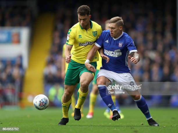 Martyn Waghorn of Ipswich and Yanic Wildschut of Norwich City battle for possession during the Sky Bet Championship match between Ipswich Town and...