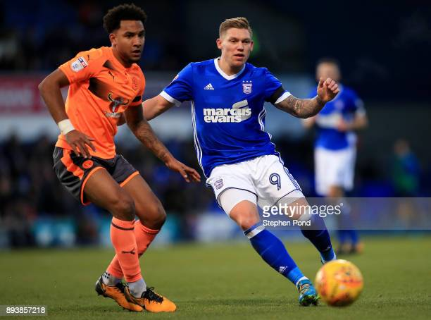 Martyn Waghorn of Ipswich Town and Liam Moore of Reading compete for the ball during the Sky Bet Championship match between Ipswich Town and Reading...