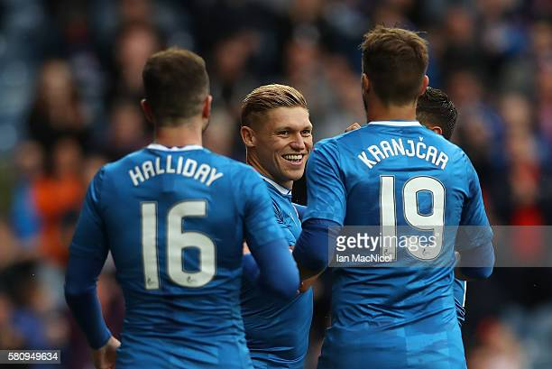 Martyn Waghorn of Rangers is congratulated after he opens the scoring from the penalty spot during the Betfred Cup match between Rangers and...