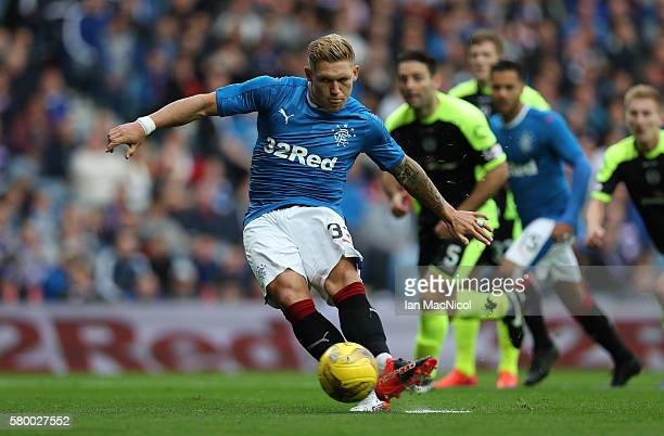 <Martyn Waghorn of Rangers opens the scoring from the penalty spot during the Betfred Cup match between Rangers and Stranraer at Ibrox Stadium on...