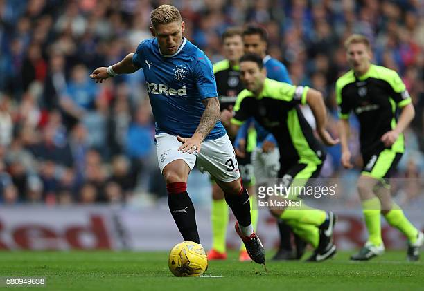 Martyn Waghorn of Rangers opens the scoring from the penalty spot during the Betfred Cup match between Rangers and Stranraer at Ibrox Stadium on July...