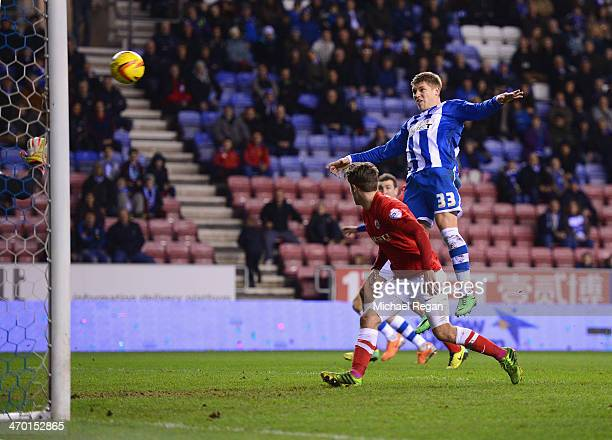Martyn Waghorn of Wigan scores to make it 20 during the Sky Bet Championship match between Wigan Athletic and Barnsley at the DW Stadium on February...