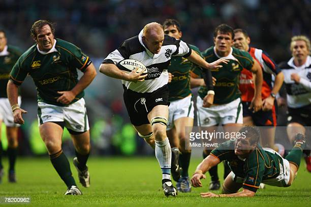 Martyn Williams of the Barbarians goes past the challenge of Johan Muller of South Africa to score his team's second try during the Gartmore...