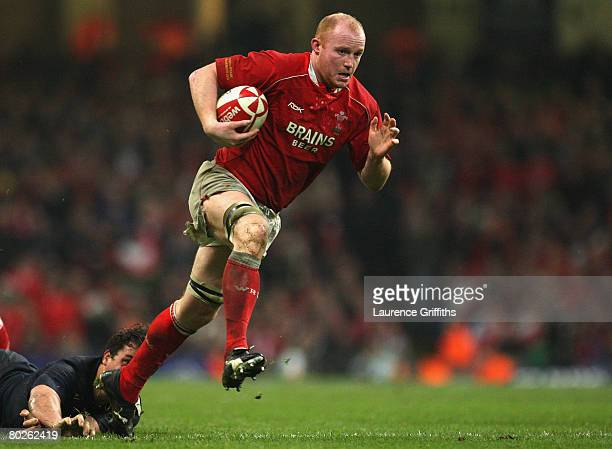 Martyn Williams of Wales brushes aside the tackle from Yannick Jauzion of France to score his team' s second try during the RBS Six Nations...