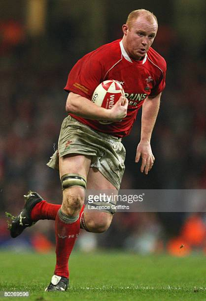 Martyn Williams of Wales runs with the ball during the RBS Six Nations Championship match between Wales and France at the Millennium Stadium on March...
