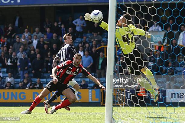Martyn Woolford of Millwall beats Steve Cook of Bournemouth to the ball to score their first goal of the game during the Sky Bet Championship match...
