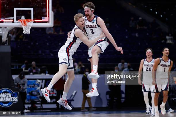 Martynas Arlauskas and Drew Timme of the Gonzaga Bulldogs celebrate defeating the USC Trojans 85-66 in the Elite Eight round game of the 2021 NCAA...