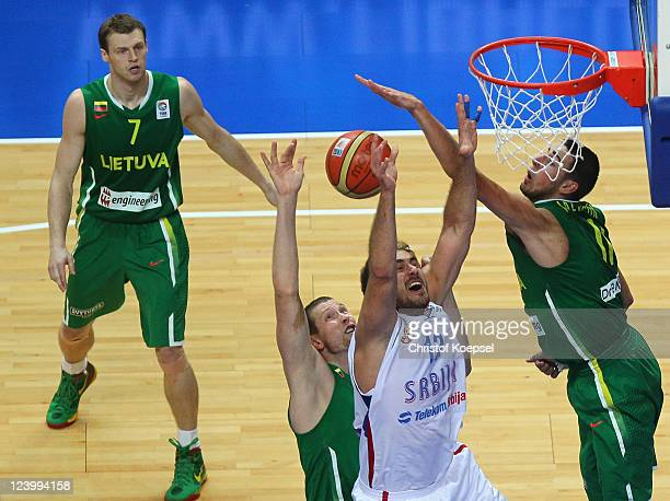 Martynas Pocius Darius Songaila and Jonas Valanciunas of Lithuania defend against Nenad Krstic of Serbia during the EuroBasket 2011 second round...