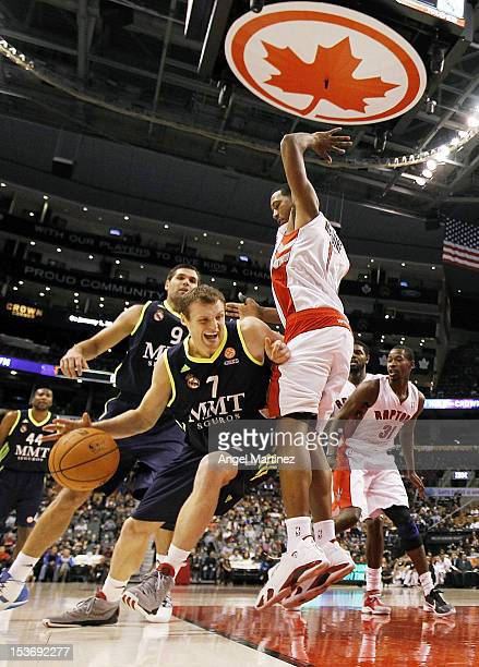 8a8f6d566a19 Martynas Pocius of Real Madrid drives against Dominic McGuire of the  Toronto Raptors during the Euroleague