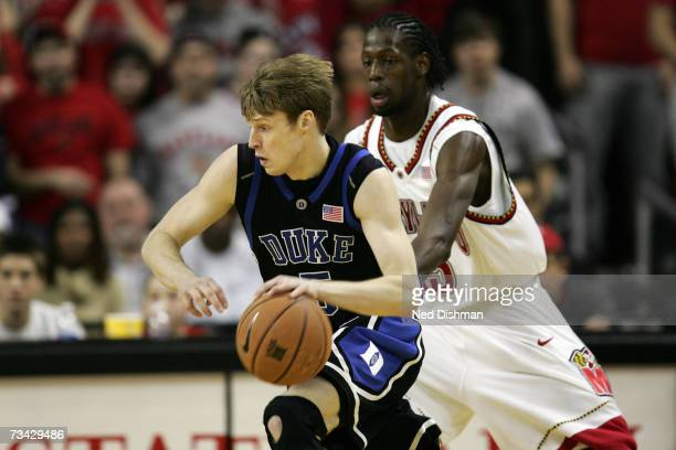 Martynas Pocius of the Duke University Blue Devils drives against James Gist of the University of Maryland Terrapins at the Comcast Center on...