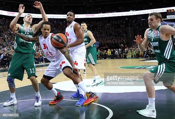 Martynas Pocius Tadas Klimavicius of Zalgiris Kaunas vies with David Moss of EA7 Emporio Armani Milano during the Euroleague basketball match...