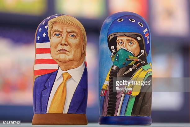 A martyoshka doll showing Donald Trump US president elect left sits beside a doll showing Vladimir Putin Russia's president dressed as a military...