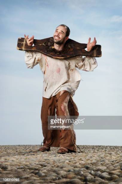 martyr in a pillory, looking up - pillory stock pictures, royalty-free photos & images