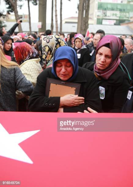 Martyred soldier Ilker Agcay's mother Gulhanim Agcay mourns over the coffin of his son in Kocaeli Turkey on February 10 2018 Ilker Agcay was martyred...