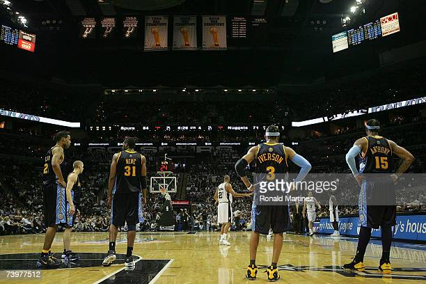 Marucs Camby Steve Blake Nene Allen Iverson and Carmelo Anthony of the Denver Nuggets wait for the San Antonio Spurs in Game Two of the Western...