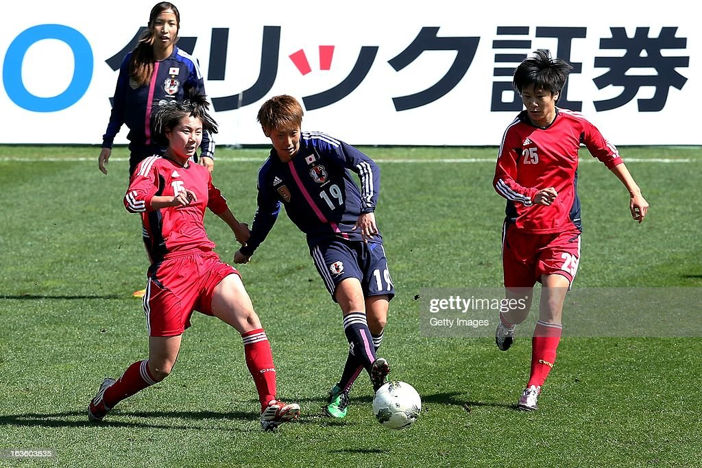 Marumi Yamazaki of Japan challenges Lei Jiahui and Zhang Rui of China during the Algarve Cup 2013 fifth place match at the Estadio Algarve on March 13, 2013 in Faro, Portugal.