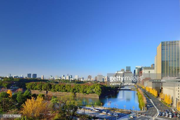 marunouchi cityscape view - imperial palace tokyo stock pictures, royalty-free photos & images