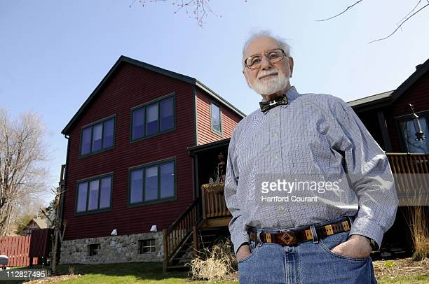 Marv Beloff pictured April 2 stands near the house he built eight years ago that he heats and cools with a geothermal system in Middlefield...