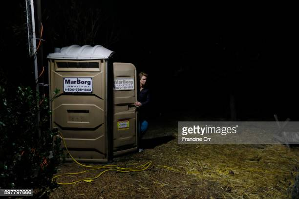 Marva Ericson exits a porta potty in a parking lot in the middle of the night in Santa Barbara CA on December 20 2017 She participates in a safe...