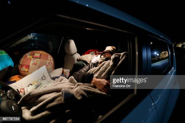 Marva Ericson gets ready to fall asleep in a Santa Barbara CA parking lot in the middle of the night on December 20 2017 It's cold and she likes lots...