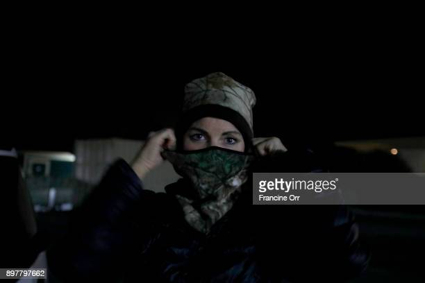 Marva Ericson gets ready to fall asleep in a Santa Barbara CA parking lot in the middle of the night on December 20 2017 It's cold and she puts on a...