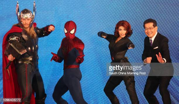 Marvel characters Thor SpiderMan Black Widow and Hong Kong Secretary for Commerce and Economic Development Gregory So Kamleung pose for a picture...