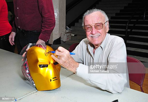 """Marvel Comics legend and """"Iron Man"""" co-creator Stan Lee signs an """"Iron Man"""" mask at the Los Angeles Comic Book and Science Fiction Convention held at..."""