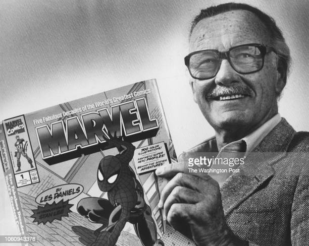 Marvel Comics Publisher Stan Lee poses with a book of Spider Man comics which he created along with comics on the Hulk and others Photo from...