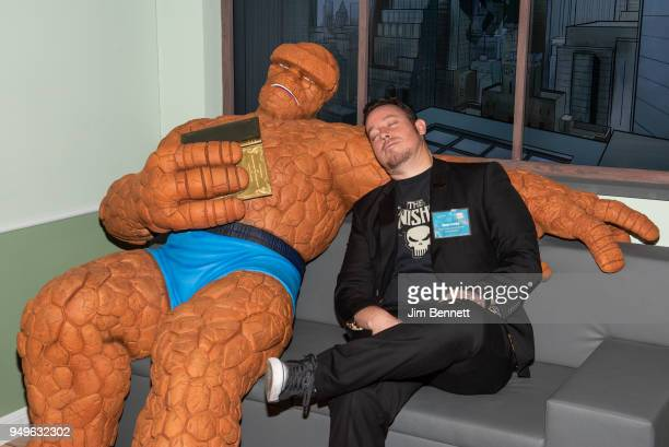 Marvel creative director Brian Crosby sits with The Thing during the opening night of the exhibit Marvel: Universe of Super Heroes at MoPop on April...