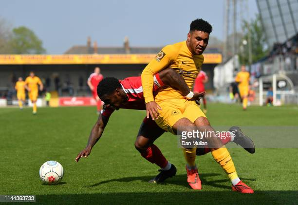 Marvel Ekpiteta of Hungerford Town and Jamie Reid of Torquay United battle for the ball during the Vanarama National League South match between...
