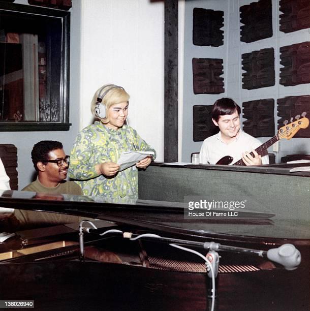 Marvell Thomas R and B singer Etta James and David Hood recording at Fame Studios circa 1967 in Muscle Shoals Alabama