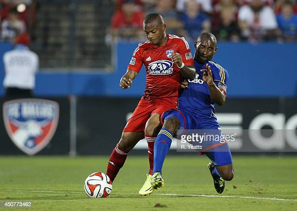 Marvell Wynne of Colorado Rapids fights with Andres Escobar of FC Dallas for control of the ball at Toyota Stadium on June 7 2014 in Frisco Texas