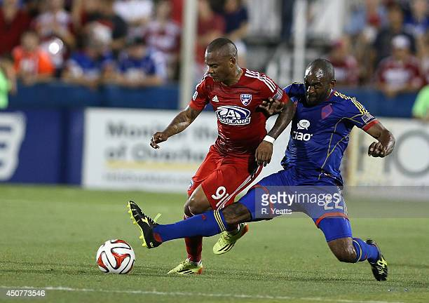 Marvell Wynne of Colorado Rapids tries to kick the ball away from Andres Escobar of FC Dallas at Toyota Stadium on June 7 2014 in Frisco Texas