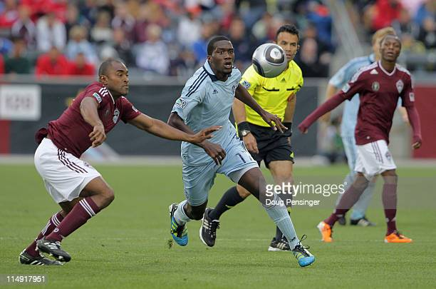 Marvell Wynne of the Colorado Rapids and CJ Sapong of the Sporting KC look to control the ball at Dick's Sporting Goods Park on May 28 2011 in...