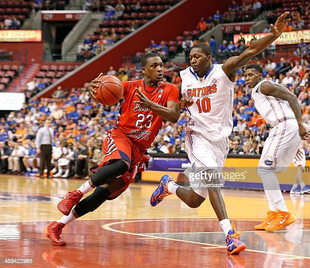 Marvelle Harris of the Fresno State Bulldogs dribbles the ball against Dorian FinneySmith of the Florida Gators during the MetroPCS Orange Bowl...