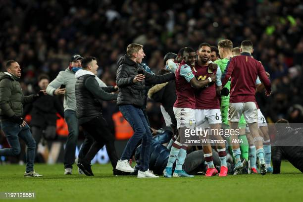Marvelous Nakamba and Douglas Luiz of Aston Villa mobbed by fans at full time during the Carabao Cup Semi Final match between Aston Villa and...