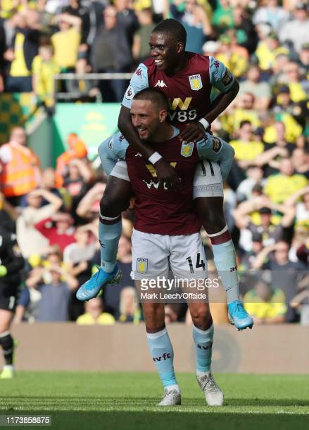 Marvelous Nakamba of Aston Villa celebrates by jumping on goalscorer Conor Hourihane during the Premier League match between Norwich City and Aston...