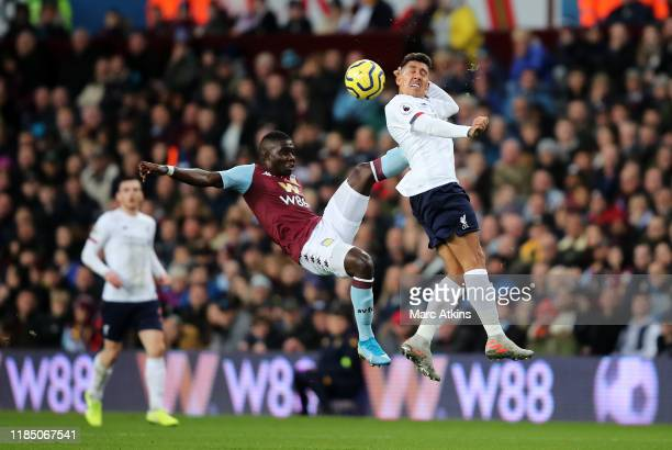 Marvelous Nakamba of Aston Villa jumps for the ball with Roberto Firmino of Liverpool during the Premier League match between Aston Villa and...