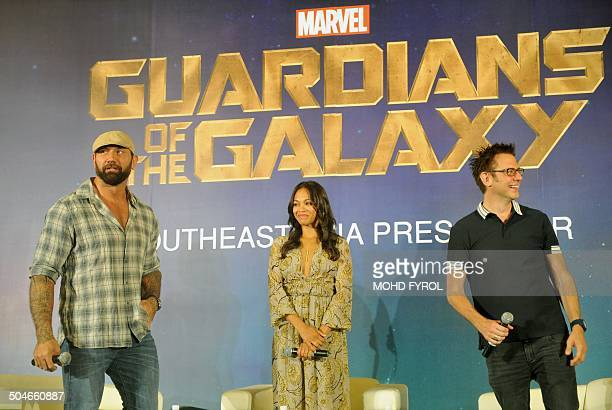 Marvel's Guardians of the Galaxy Director James Gunn with the casts Dave Bautista and Zoe Saldana attend a photo call at Marina Bay Sands in...