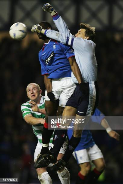Marvin Andrews of Rangers clashes with his own goal keeper Stefan Klos as John Hartson of Celtic looks on during the CIS Insurance Cup fourth round...